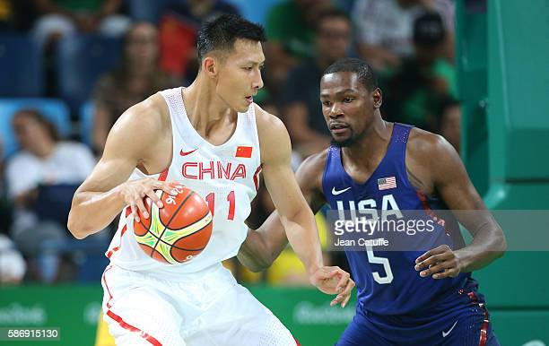 Jianlian Yi of China and Kevin Durant of USA in action during the group phase basketball match between USA and China on day 1 of the Rio 2016 Olympic...
