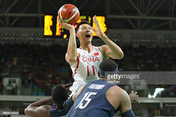 Jianlian Yi of China shoots over Carmelo Anthony of United States on Day 1 of the Rio 2016 Olympic Games at Carioca Arena 1 on August 6 2016 in Rio...