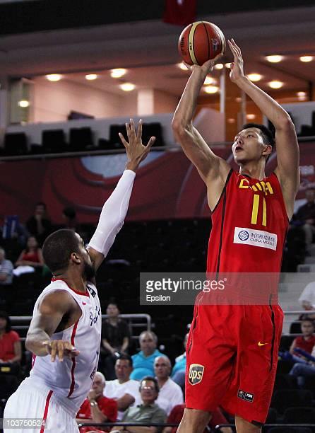 Jianlian Yi of China shoots over Ricardo Sanchez of Puerto Rico at the 2010 World Championships of Basketball during the game between China vs Puerto...