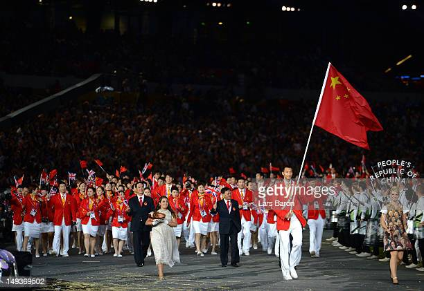 Jianlian Yi of the China Olympic basketball team carries his countires flag during the Opening Ceremony of the London 2012 Olympic Games at the...