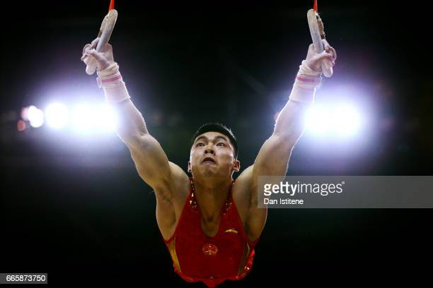 Jianlin Luo of China takes part in a practice session on the rings during previews to the iPro Sport World Cup of Gymnastics at The O2 Arena on April...