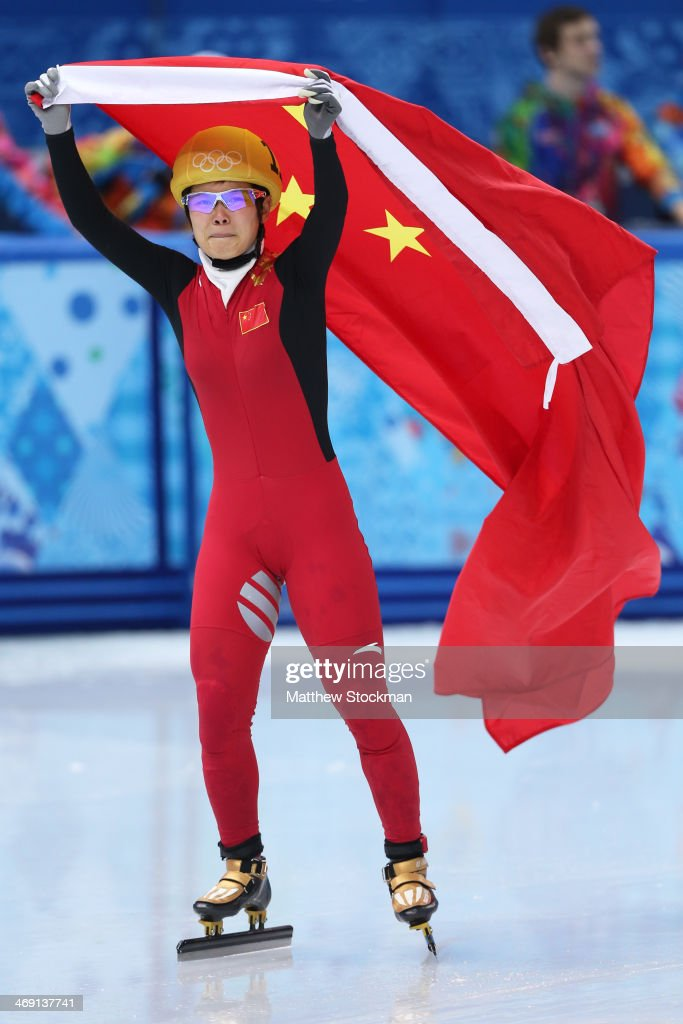 Jianrou Li of China celebrates as she wins the gold medal in the Short Track Speed Skating Ladies' 500 m Final on day 6 of the Sochi 2014 Winter Olympics at at Iceberg Skating Palace on February 13, 2014 in Sochi, Russia.