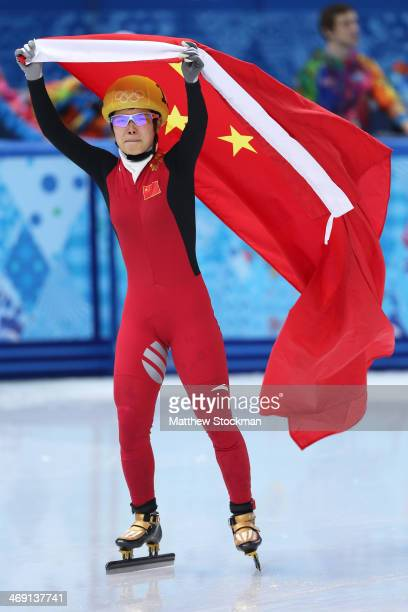 Jianrou Li of China celebrates as she wins the gold medal in the Short Track Speed Skating Ladies' 500 m Final on day 6 of the Sochi 2014 Winter...