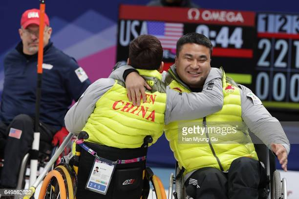 Jianxin Chen from China embraces teammate Haitao Wang from China after winning round robin session 11 the World Wheelchair Curling Championship 2017...