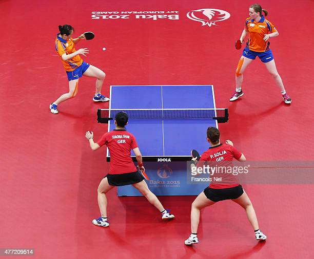 Jiao Li and Britt Eerland of the Netherlands compete in the Women's Team Table Tennis gold medal match against Xiaona Shan and Petrissa Solja of...
