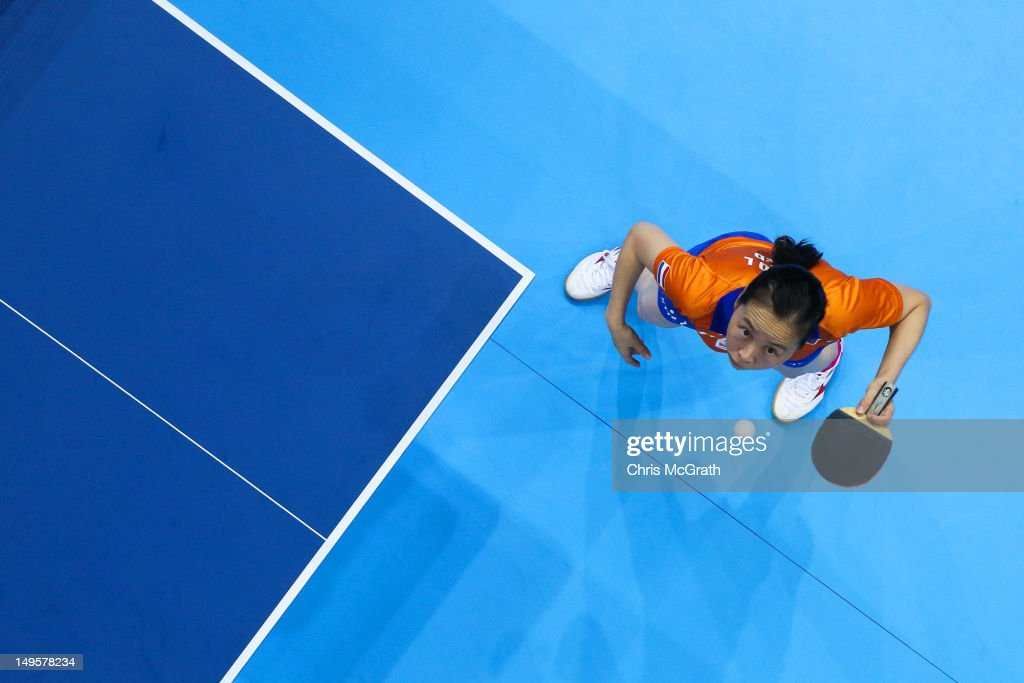 Jiao Li of Netherlands serves during the Women's Singles Table Tennis quarter-final match against Xiaoxia Li of China on on Day 4 of the London 2012 Olympic Games at ExCeL on July 31, 2012 in London, England.