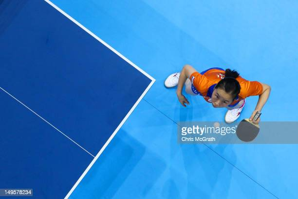 Jiao Li of Netherlands serves during the Women's Singles Table Tennis quarterfinal match against Xiaoxia Li of China on on Day 4 of the London 2012...