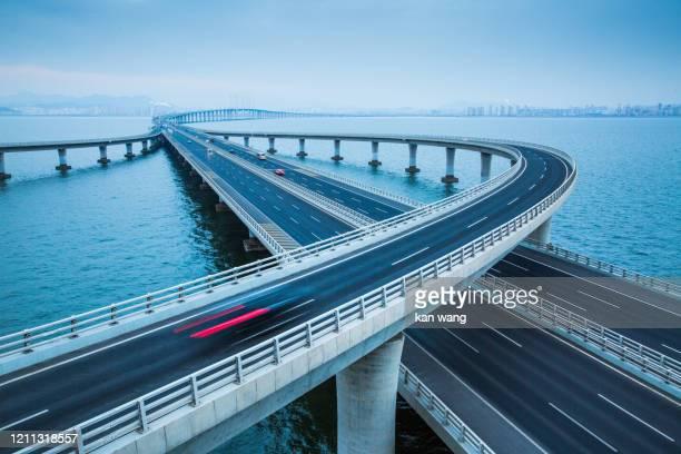 jiaozhou bay bridge of qingdao,shandong province,china - stock photo - wang he stock pictures, royalty-free photos & images