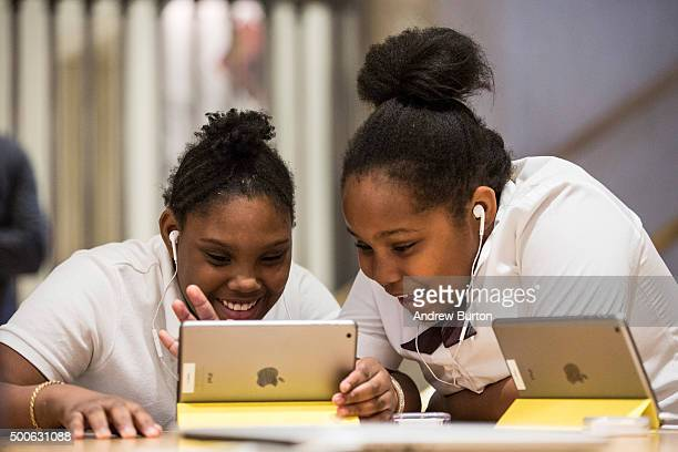 Jiavaennye Green and Taylor Phillips third grade children from PS 57 James Weldon Johnson Leadership Academy learn how to code at an Apple Store...