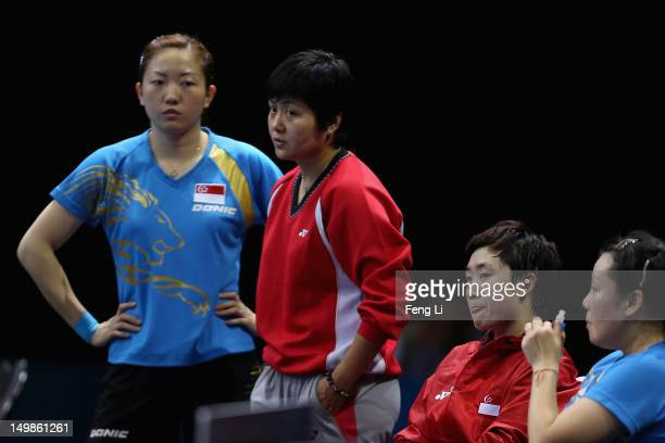 Jiawei Li, Tianwei Feng, Yuegu Wang and coach of Singapore attend Women's Team Table Tennis semifinal match against team of Japan on Day 9 of the...