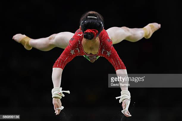 Jiaxin Tan of China competes on the uneven bars during Women's qualification for Artistic Gymnastics on Day 2 of the Rio 2016 Olympic Games at the...