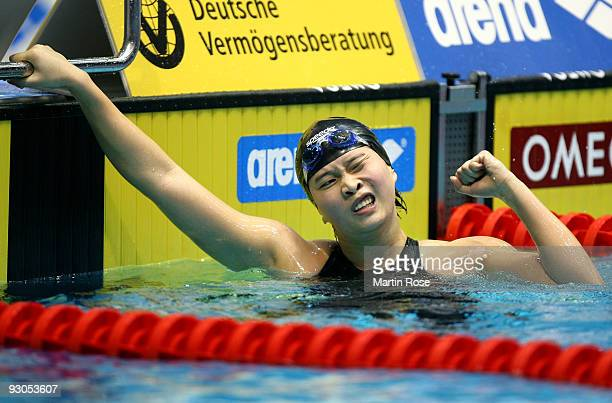 Jiaxing Li of China celebrates after winning the women's 200m individual medley final during day one of the FINA/ARENA Swimming World Cup on November...