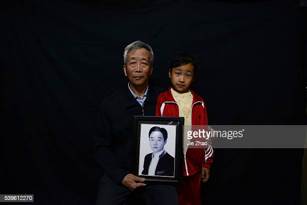 Jiaxing Zhejiang China May 12 2015 Guisheng Guo 68 and his granddaughter Yuanyuan Guo pose for photography The lady in the picture is Yuanyuan's...