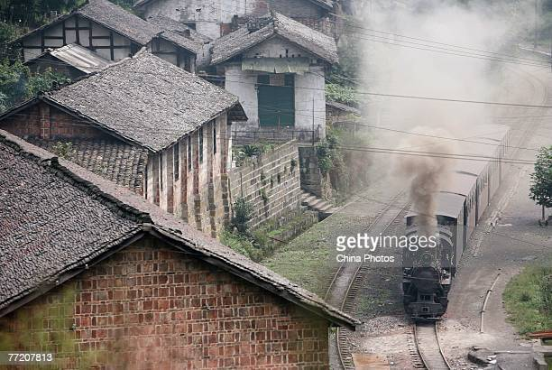Jiayang Trainset runs into the terminal station on October 5, 2007 in Qianwei County of Leshen City, Sichuan Province, China. The narrow-gauge...