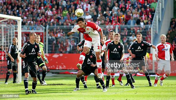 Jiayi Shao of Cottbus heads the ball during the Bundesliga Play Off match between FC Energie Cottbus and 1.FC Nuernberg at the Stadion der...