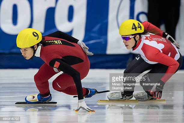 Jiaying Tao of China competes against Valerie Maltais of Canada on Day 2 of the ISU World Cup Short Track Speed Skating competition at MauriceRichard...