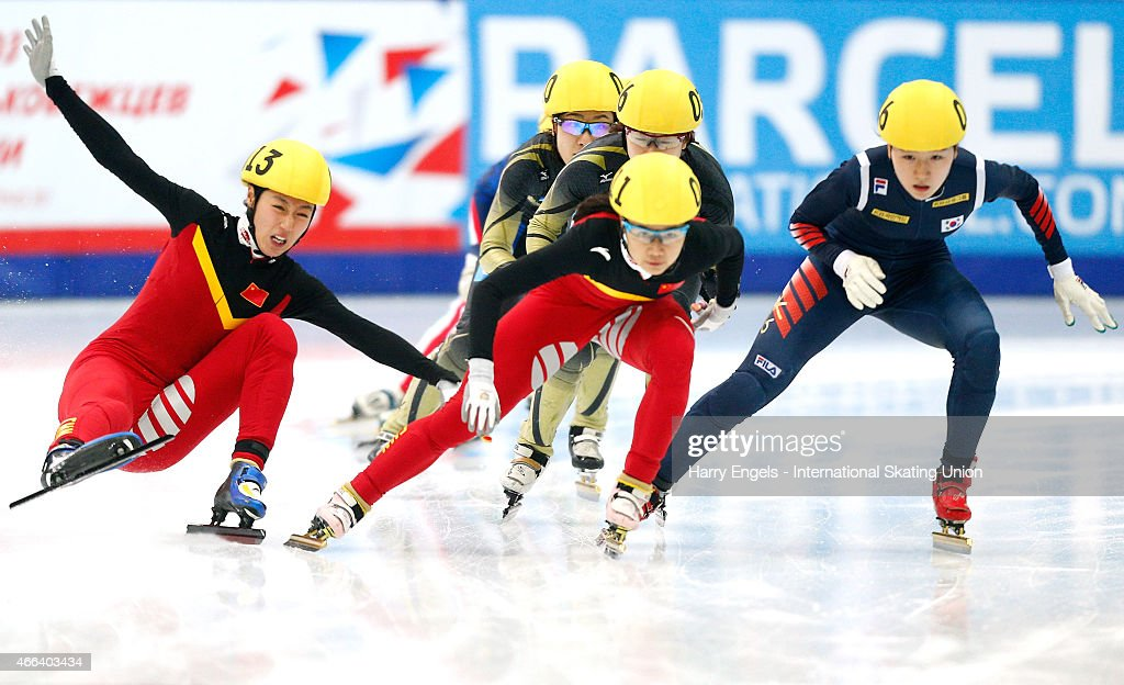 Jiaying Tao of China (L) falls during the Ladies' 3000m Relay on day three of the ISU World Short Track Speed Skating Championships at the Krylatskoe Speed Skating Centre on March 15, 2015 in Moscow, Russia.