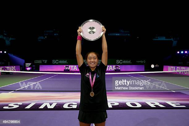 Jiayu Chu of China hold up her trophy after defeating Fitriani Sabatini of India in the Future Stars U14 Final during the BNP Paribas WTA Finals at...