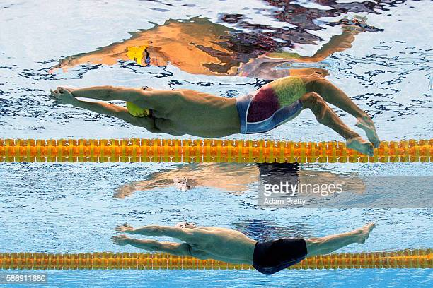 Jiayu Xu of China and Ryan Murphy of the United States compete in the Men's 100m Backstroke heat on Day 2 of the Rio 2016 Olympic Games at the...
