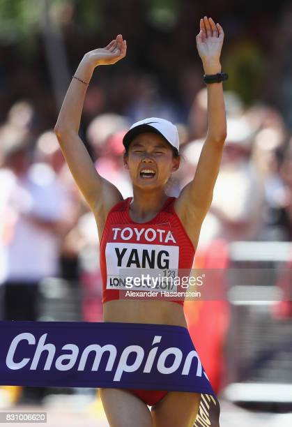 Jiayu Yang of China celebrates as she crosses the line to win gold in the Women's 20km Race Walk final during day ten of the 16th IAAF World...