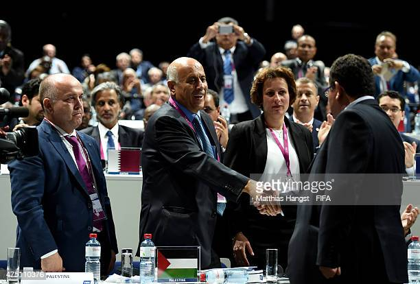 Jibril Al Rajoub President of the Palestinian Football Association shakes hands with Ofer Eini President of the Israel Football Association during...
