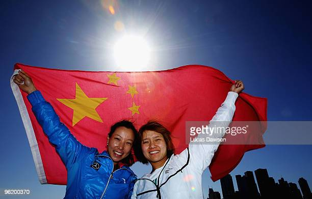 Jie Zheng and Na Li of China pose with the Chinese flag at Grand Slam Oval during day ten of the 2010 Australian Open at Melbourne Park on January...