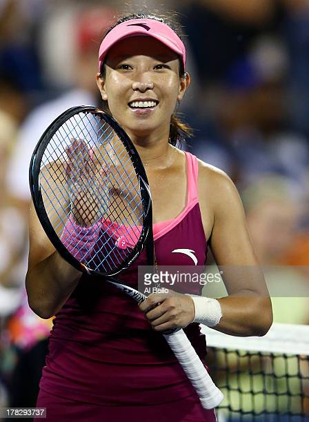 Jie Zheng of China applauds the crowd as she celebrates victory against Venus Williams of the United States of America during their woman's singles...