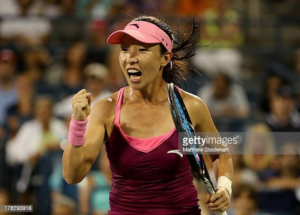 Jie Zheng of China celebrates a point against Venus Williams of the United States of America during their woman's singles second round match on Day...