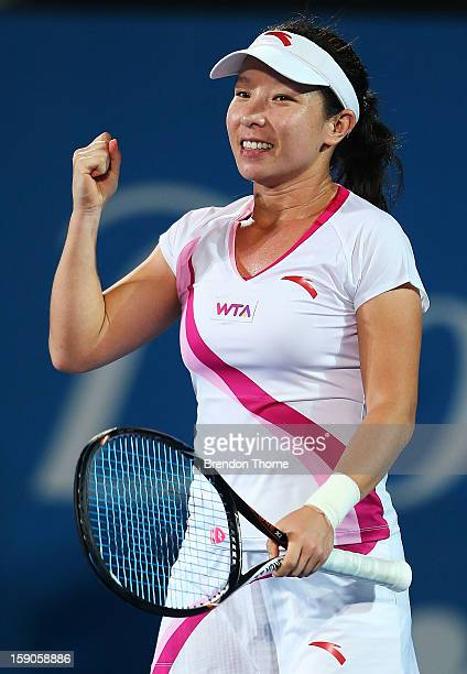Jie Zheng of China celebrates after winning her first round match against Samantha Stosur of Australia during day two of the Sydney International at...