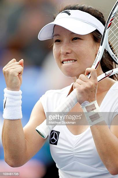 Jie Zheng of China celebrates match point against Elena Dementieva of Russia during the Rogers Cup at Stade Uniprix on August 19, 2010 in Montreal,...