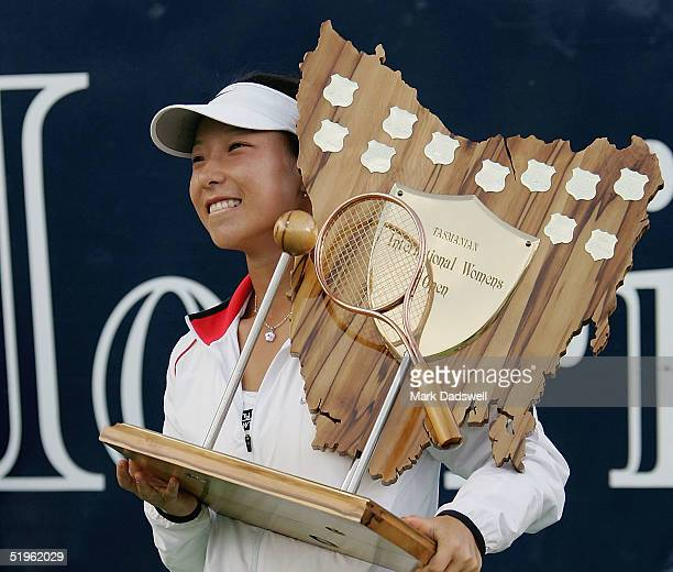 Jie Zheng of China celebrates with her trophy after defeating Gisela Dulko of Argentina during day six of the Moorilla International at the Domain...
