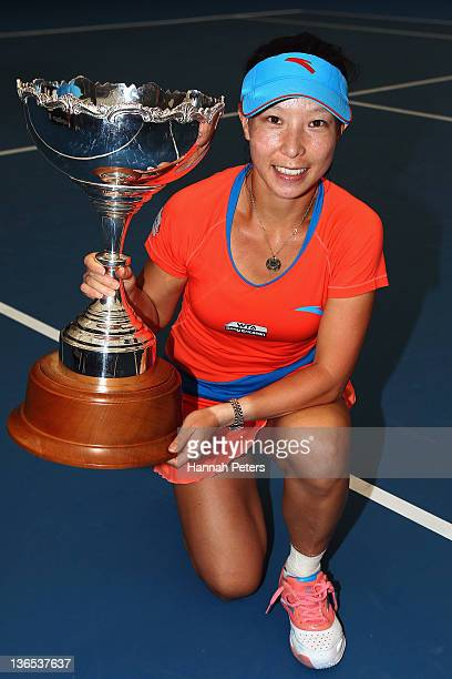Jie Zheng of China holds up the trophy after beating Flavia Pennetta of Italy in the Women's final during day seven of the 2012 ASB Classic at ASB...