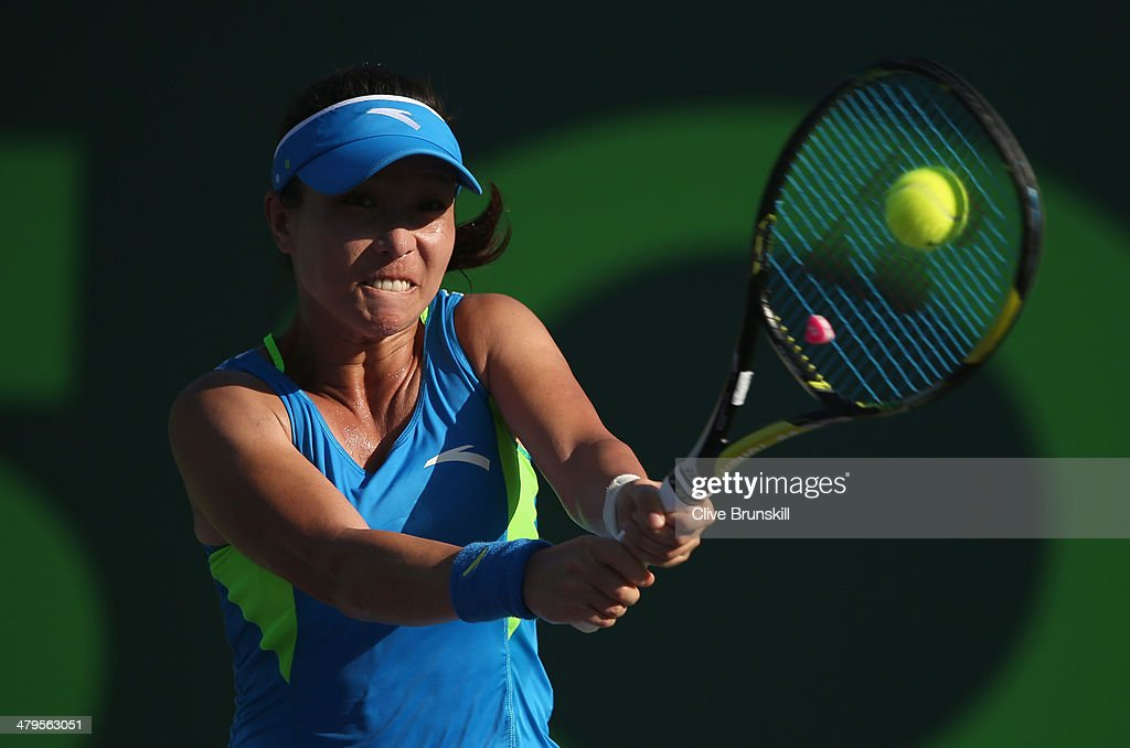 Jie Zheng of China plays a backhand against Christina McHale of the United States during their first round match during day 3 at the Sony Open at Crandon Park Tennis Center on March 19, 2014 in Key Biscayne, Florida.