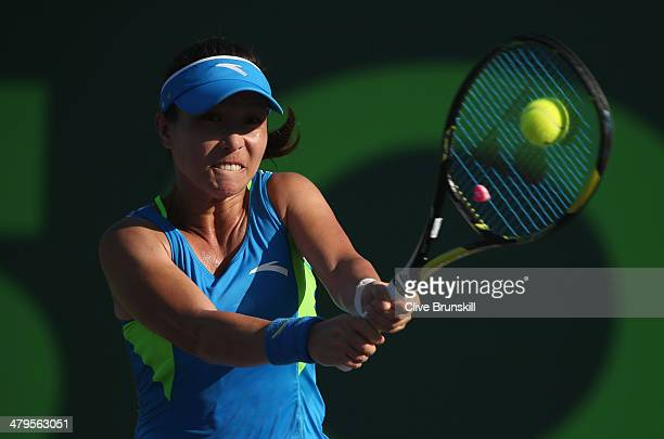 Jie Zheng of China plays a backhand against Christina McHale of the United States during their first round match during day 3 at the Sony Open at...