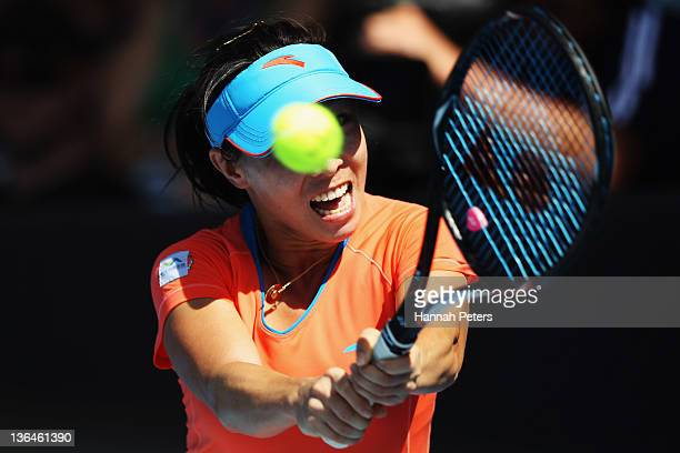 Jie Zheng of China plays a backhand during her match against Svetlana Kuznetsova of Russia during day five of the 2012 ASB Classic ASB Tennis Centre...