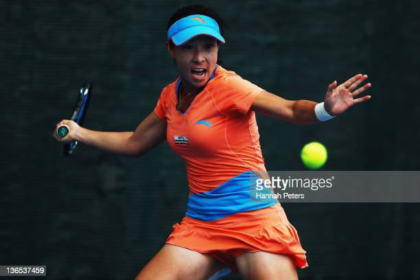 Jie Zheng of China plays a forehand against Flavia Pennetta of Italy in the Women's final during day seven of the 2012 ASB Classic at ASB Tennis...