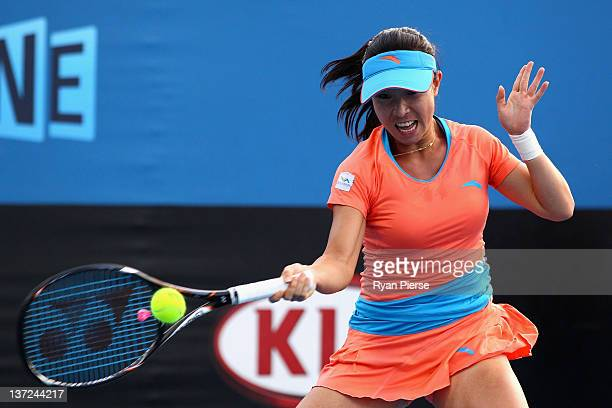 Jie Zheng of China plays a forehand during her first round match against Madison Keys of the United States during day two of the 2012 Australian Open...