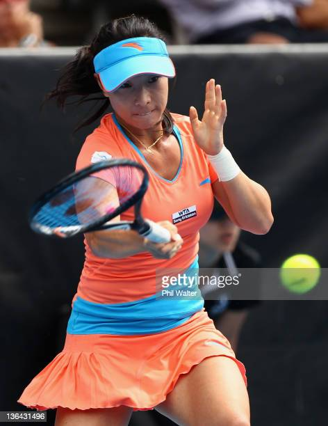 Jie Zheng of China plays a forehand in her match against Lucie Hradecka of the Czech Republic during day four of the 2012 ASB Classic at the ASB...