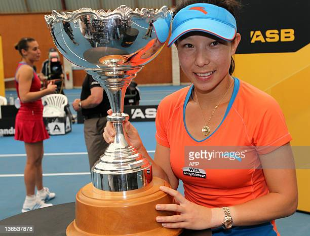 Jie Zheng of China poses with the trophy after winning her match against Flavia Pennetta of Italy in the singles final of the ASB Classic Tennis at...