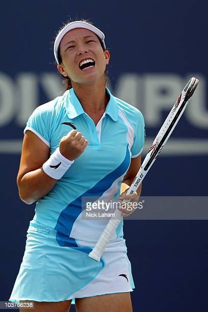 Jie Zheng of China reacts after losing a point against Ana Ivanovic of Serbia during her second round women's singles match on day three of the 2010...