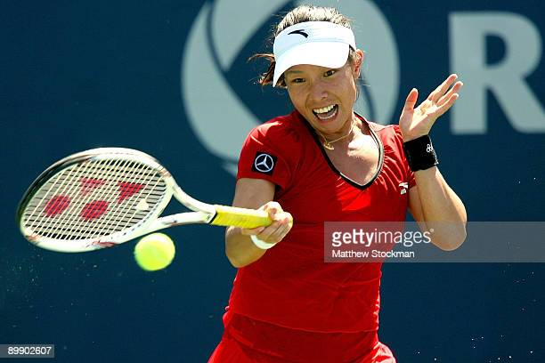 Jie Zheng of China returns a shot against Caroline Wozniack of Denmark during the Rogers Cup at the Rexall Center on August 19 in Toronto Ontario...