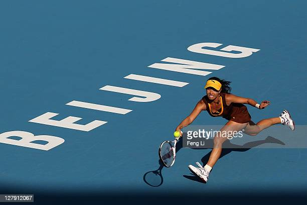 Jie Zheng of China returns a shot to Alberta Brianti of Italy during day three of the China Open at the National Tennis Center on October 3 2011 in...