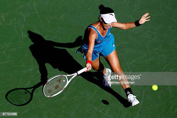 Jie Zheng of China returns a shot to Maria Sharapova of Russia during the BNP Paribas Open on March 14 2010 in Indian Wells California