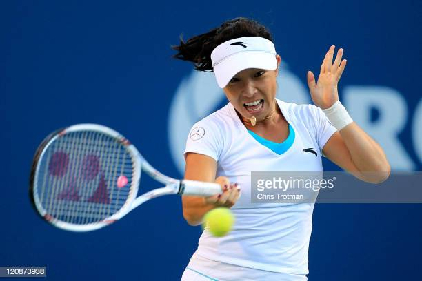 Jie Zheng of China returns to Serena Williams on Day 4 of the Rogers Cup presented by National Bank at the Rexall Centre on August 11 2011 in Toronto...