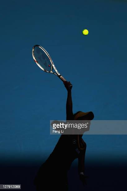 Jie Zheng of China serves a shot to Alberta Brianti of Italy during day three of the China Open at the National Tennis Center on October 3 2011 in...