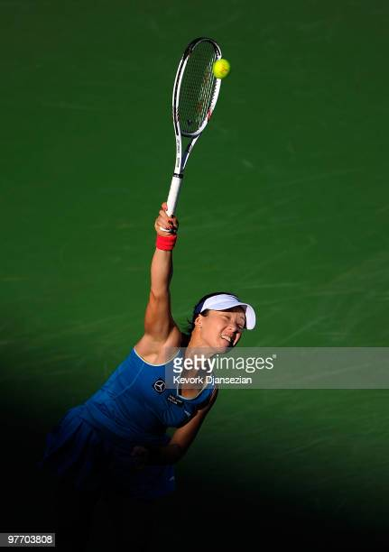 Jie Zheng of China serves against Maria Sharapova of Russia during the BNP Paribas Open on March 14 2010 in Indian Wells California