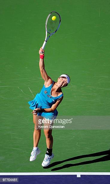 Jie Zheng of China serves against Maria Sharapova of Russia during the BNP Paribas Opne on March 14 2010 in Indian Wells California