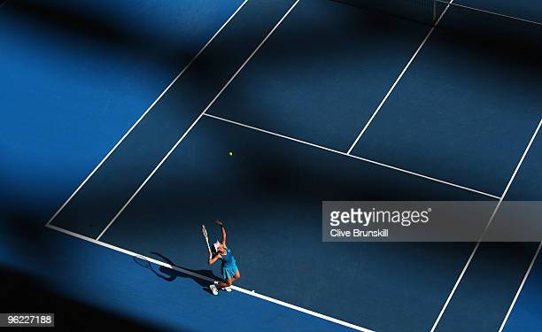 Jie Zheng of China serves in her semifinal match against Justine Henin of Belgium during day eleven of the 2010 Australian Open at Melbourne Park on...