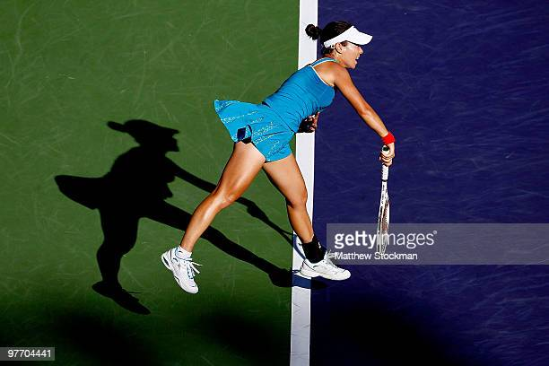 Jie Zheng of China serves to Maria Sharapova of Russia during the BNP Paribas Open on March 14 2010 in Indian Wells California