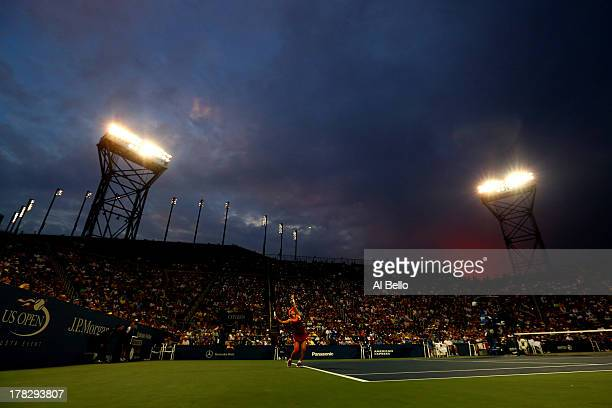 Jie Zheng of China serves to Venus Williams of the United States of America during their woman's singles second round match on Day Three of the 2013...